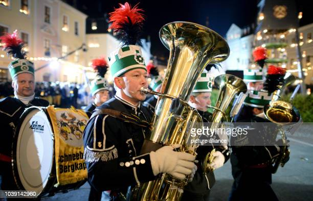 Members of the Schneeberg brass band perform with five more music bands and more than 500 participants in tradition costumes in a traditional great...