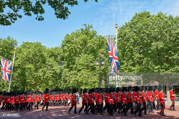 Members of the Scots Guards and Welsh Guards march along the mall before the Britain's Queen Elizabeth II travels to the Palace of Westminster in...