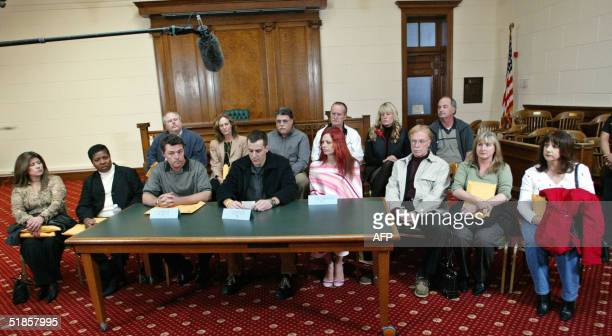 Members of the Scott Peterson jury sit together as they read a statement during a news conference December 13 2004 in Redwood City California Seen at...