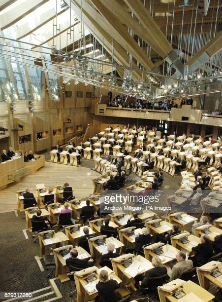 Members of the Scottish Parliament in the debating chamber on the first day of the new Scottish Parliament at Holyrood 09/09/04 Most Scots think the...