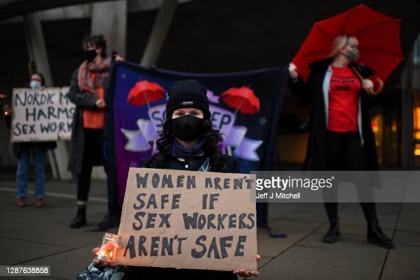 Members of the Scottish sex industry hold a vigil outside the Scottish Parliament on November 25, 2020 in Edimnurgh,Scotland. The sex workers are...