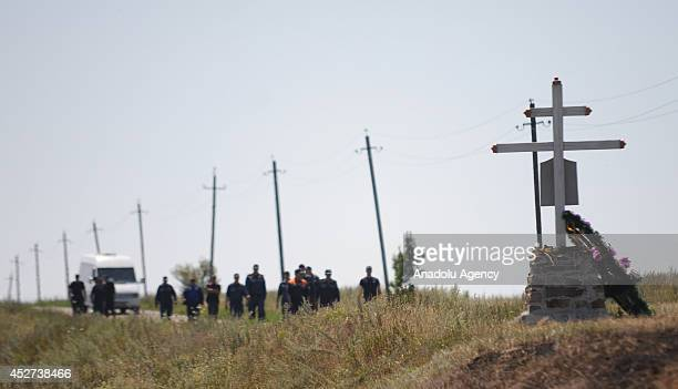 Members of the search and rescue team search the field around the crash site of the Malaysia Airlines flight MH17 near the Grabovo town in Donetsk...