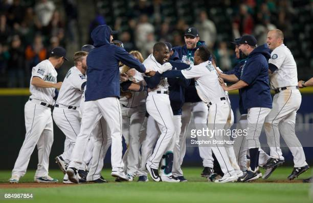 Members of the Seattle Mariners celebrate a walk off RBI single by Guillermo Heredia of the Seattle Mariners off of relief pitcher Dan Jennings of...