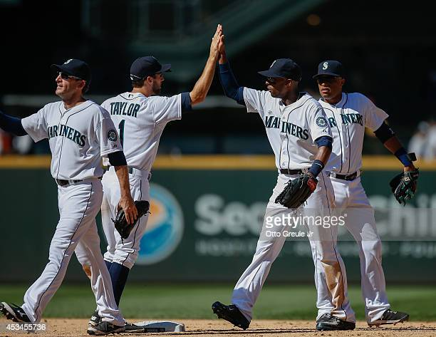 Members of the Seattle Mariners celebrate after defeating the Chicago White Sox 42 at Safeco Field on August 10 2014 in Seattle Washington