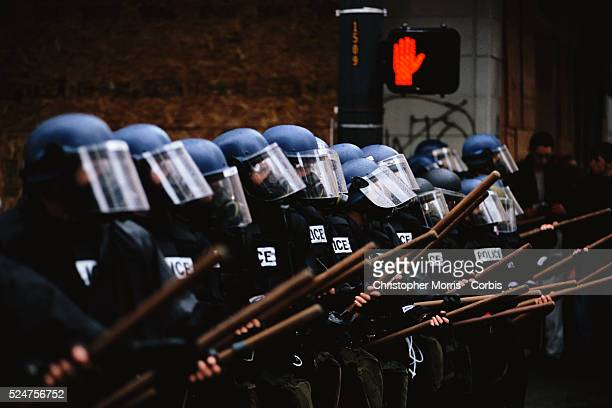 Members of the Seattle Police in riot gear line up to face protesters during the World Trade Organization's 1999 conference in Seattle What started...