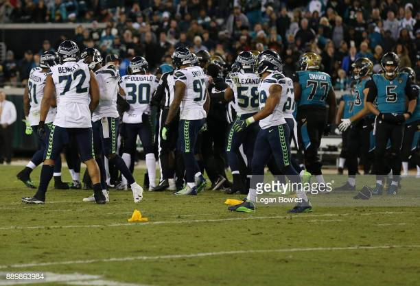 Members of the Seattle Seahawks and tyhe Jacksonville Jaguars tussle on the field during the second half of their game at EverBank Field on December...