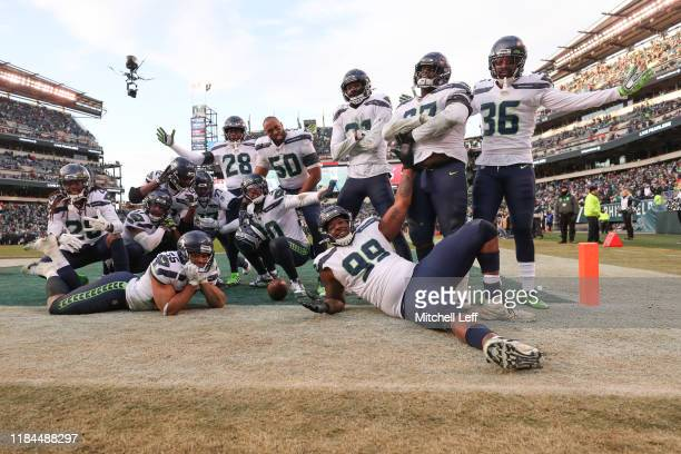 Members of the Seattle Seahawks celebrate after an interception against the Philadelphia Eagles in the fourth quarter at Lincoln Financial Field on...