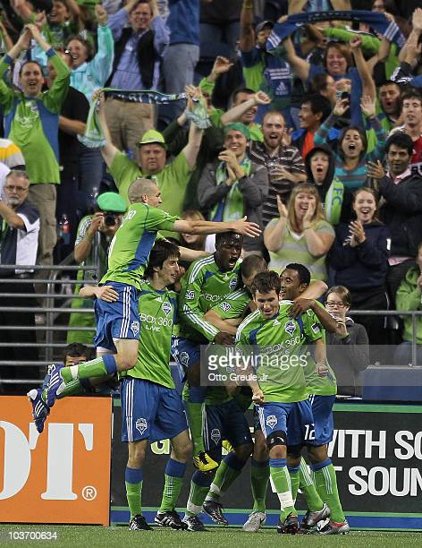 Members of the Seattle Sounders FC celebrate after Fredy Montero scored the winning goal to defeat the Chicago Fire 2-1 on August 28, 2010 at Qwest...