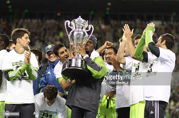 Members of the Seattle Sounders FC hold US Open Cup trophies after defeating the Chicago Fire 20 in the 2011 Lamar Hunt US Open Cup Final at...