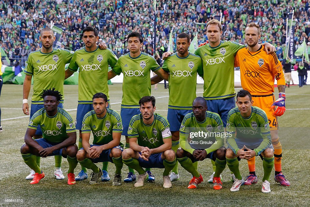 Members of the Seattle Sounders FC pose for the team photo prior to the match against the New England Revolution at CenturyLink Field on March 8, 2015 in Seattle, Washington. The Sounders defeated the Revolution 3-0.