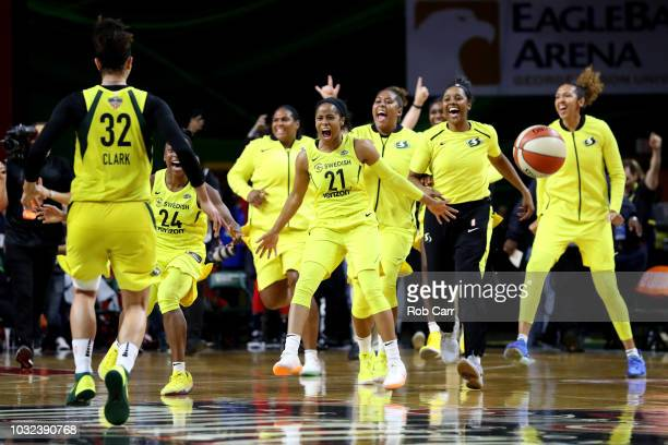 Members of the Seattle Storm celebrate after defeating the Washington Mystics 9882 to win the WNBA Finals at EagleBank Arena on September 12 2018 in...