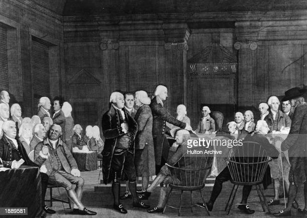 Members of the Second Continental Congress prepare documentation for the Declaration of Independence in the Assembly Room of the Pennsylvania State...