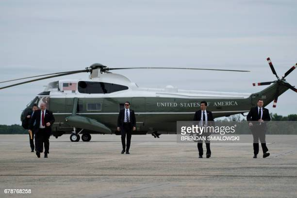 Members of the Secret Service arrive to board Air Force One to escort US President Donald Trump at Andrews Air Force Base May 4 2017 in Maryland /...