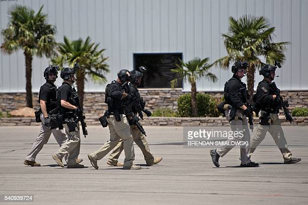 Members of the Secret Service arrive to escort US President Barack Obama and the first family at a landing zone June 17 2016 in Carlsbad New Mexico /...