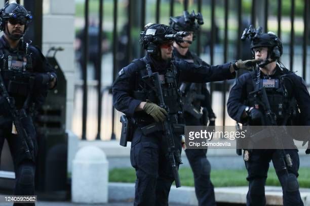 Members of the Secret Service counter assault team return to the White House after US President Donald Trump posed for photographs in front of St...