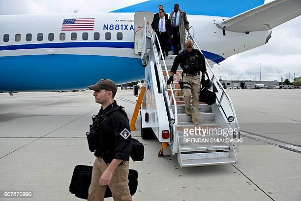 Members of the Secret Service escorting Democratic presidential nominee Hillary Clinton arrive at Philadelphia International Airport September 19...