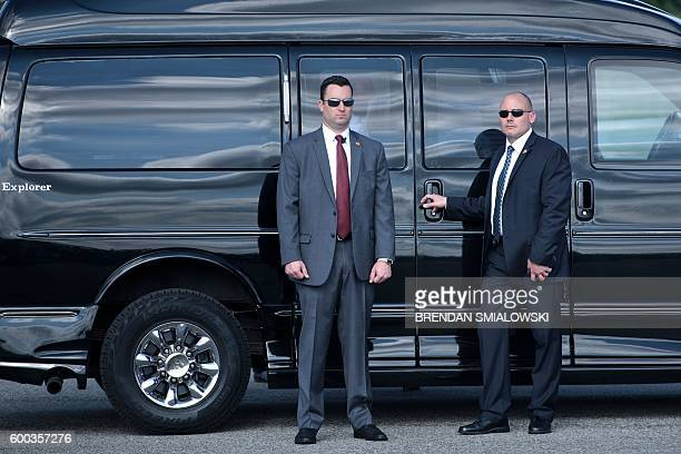 Members of the Secret Service guard Democratic presidential nominee Hillary Clinton's van before she speaks to the press at Westchester County...