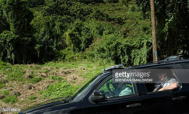 Members of the Secret Service ride in a motorcade with US President Barack Obama and US First Lady Michelle Obama while traveling from Maliki State...