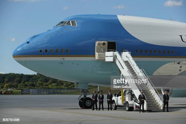 Members of the Secret Service stand next to Air Force One following the arrival of US President Donald Trump and First Lady Melania Trump at Hamburg...