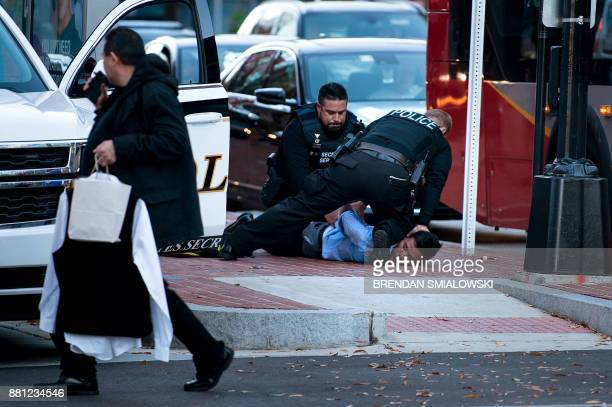 Members of the Secret Service take a man into custody on K Street NW on November 28 2017 in Washington DC / AFP PHOTO / Brendan Smialowski