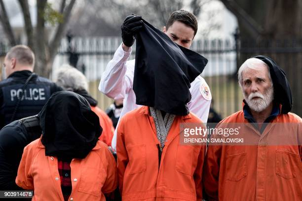 Members of the Secret Service take activists into custody as they protest the Guantanamo Bay detention camp on Pennsylvania Avenue outside the White...
