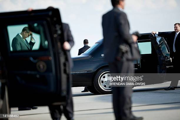 Members of the Secret Service wait after President Barack Obama arrived at Atlanta Hartsfield Jackson International Airport March 16 2012 in Atlanta...