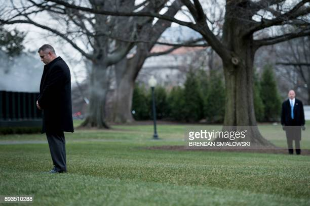 Members of the Secret Service wait for US President Donald Trump to walk to Marine One on the South Lawn of the White House December 15 2017 in...