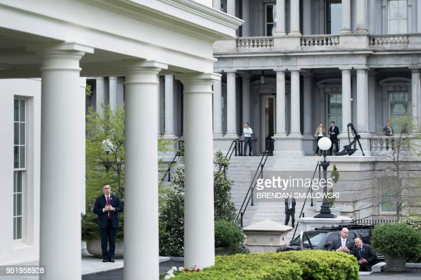 Members of the Secret Service wait for US President Donald Trump to greet Germany's Chancellor Angela Merkel outside the West Wing of the White House...