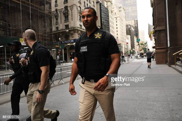 Members of the Secret Service walk in front of Trump Tower on August 14 2017 in New York City Security throughout the area is high as President...