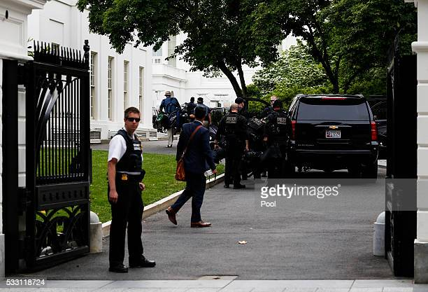 Members of the Secret Services return to the White House after US President Barack Obama went golfing at Joint Base Andrews in Maryland on May 20...