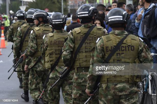 Members of the security forces patrol around the site of an explosion on a police cadet training school in Bogota on January 17 2019 The Colombian...