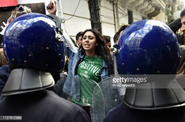 Members of the security forces stand guard as Algerian students protest in the capital Algiers against ailing President Abdelaziz Bouteflika's bid...