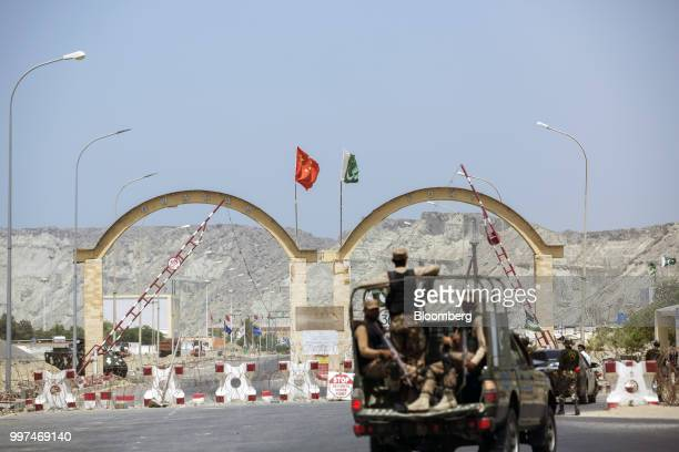 Members of the security forces stand guard at an entrance to Gwadar Port operated by China Overseas Ports Holding Co in Gwadar Balochistan Pakistan...