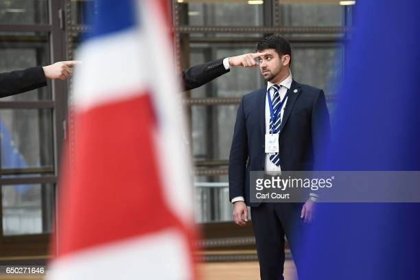 Members of the security team secure the arrival area of the Europa building at the Council of the European Union on the first day of an EU summit on...