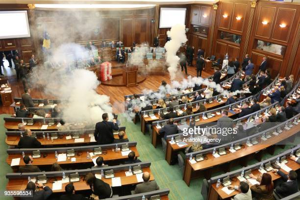 Members of the Self-Determination Movement party release a teargas canister during a parliamentary session in Pristina, Kosovo on March 21, 2018.