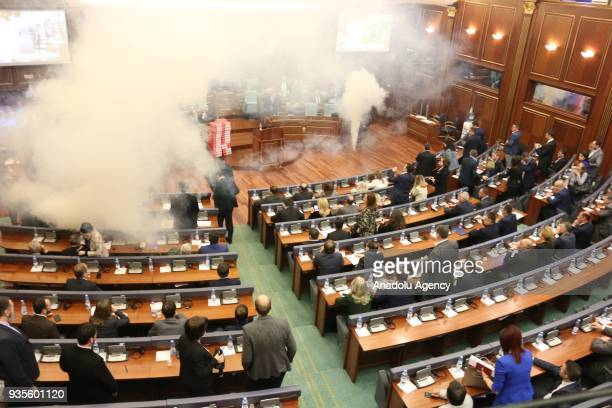 Members of the Self-Determination Movement party release a teargas canister during a parliamentary session in Pristina, Kosovo on March 21, 2018...