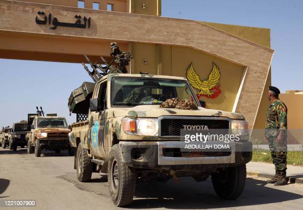 Members of the self-proclaimed eastern Libyan National Army special forces gather in the city of Benghazi, on their way to reportedly back up fellow...