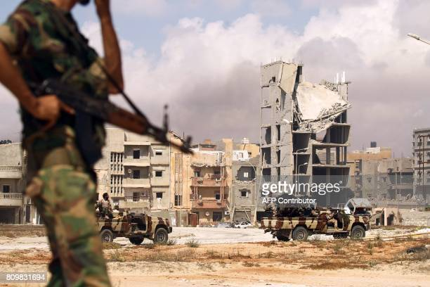 Members of the selfstyled Libyan National Army loyal to the country's east strongman Khalifa Haftar patrol a street in central Benghazi on July 6...