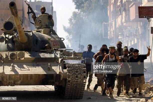 Members of the selfstyled Libyan National Army loyal to the country's east strongman Khalifa Haftar patrol a street in central Benghazi on July 6 as...