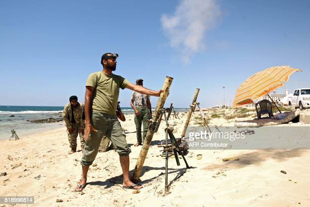 TOPSHOT Members of the selfstyled Libyan National Army loyal to the country's east strongman Khalifa Haftar fire mortar shells during clashes with...