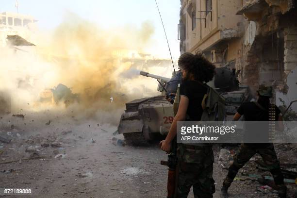 Members of the selfstyled Libyan National Army loyal to the country's east strongman Khalifa Haftar open fire during clashes with militants in...