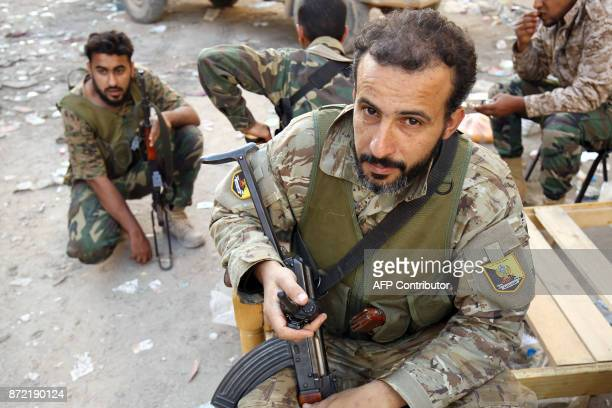 Members of the selfstyled Libyan National Army loyal to the country's east strongman Khalifa Haftar rest following clashes with militants in...