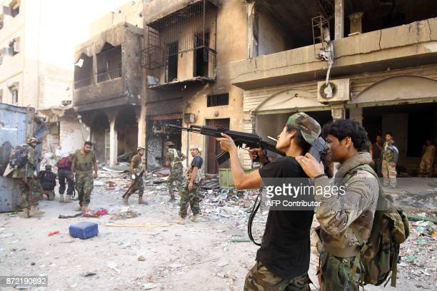 Members of the selfstyled Libyan National Army loyal to the country's east strongman Khalifa Haftar practice firing a Kalashnikov assault rifle as...