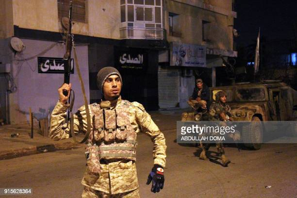 Members of the selfstyled Libyan National Army loyal to the country's east strongman Khalifa Haftar patrol the roads leading into the eastern city of...