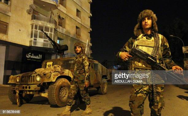 TOPSHOT Members of the selfstyled Libyan National Army loyal to the country's east strongman Khalifa Haftar patrol the roads leading into the eastern...
