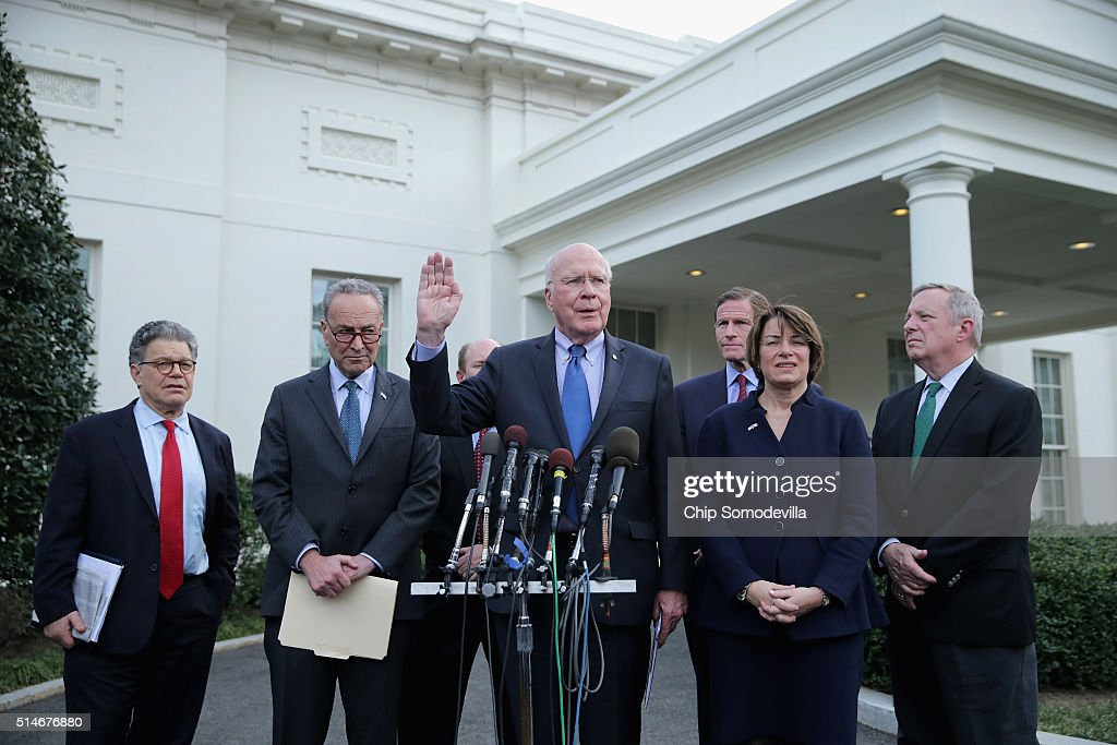 Members of the Senate Judicary Committee (L-R) Sen. Al Franken (D-MN), Sen. Charles Schumer (D-NY), Chairman Patrick Leahy (D-VT), Sen. Richard Blumenthal (D-CT), Sen. Amy Klobuchar (D-MN) and Senate Minority Whip Richard Durbin (D-IL) talk to the press following a meeting with White House officials March 10, 2016 in Washington, DC. The committee members met with White House Senior Advisor Valerie Jarrett and other officials about the ongoing Supreme Court nomination process.