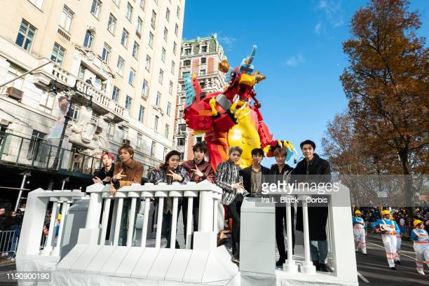 Members of the Seoulbased Kpop band NCT127 pose for a picture as they ride on the Lego The BrickChanger float as it makes its way down Central Park...
