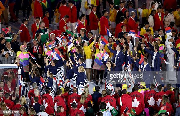 Members of the Serbia team enter the stadium during the Opening Ceremony of the Rio 2016 Olympic Games at Maracana Stadium on August 5 2016 in Rio de...
