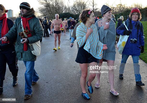Members of the Serpentine Swimming club leave the Serpentine after taking part in the annual Christmas Day morning 100 yards 'Peter Pan Cup' race in...