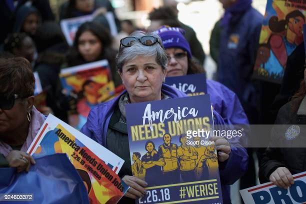 Members of the Service Employees International Union hold a rally in support of the American Federation of State County and Municipal Employees union...
